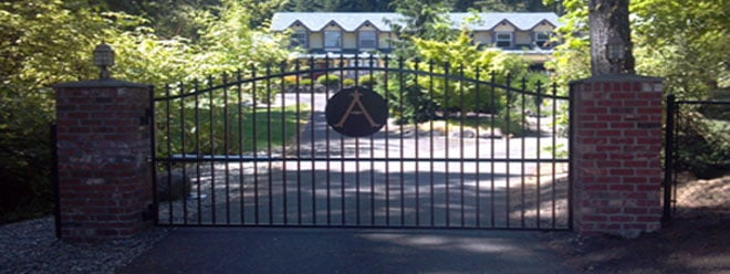 Custom Decorative Iron Driveway Gate | Powerdercoated | Copper Vein Letter Symbol | Automatic Opening with Brick Columns